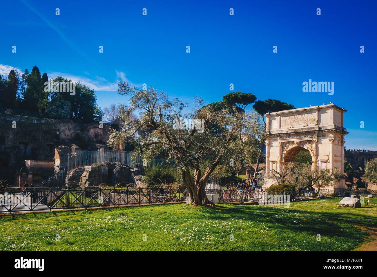 Titus Arch (Arco di Tito) and Via Sacra Roman Road in Rome, Italy - Stock Image