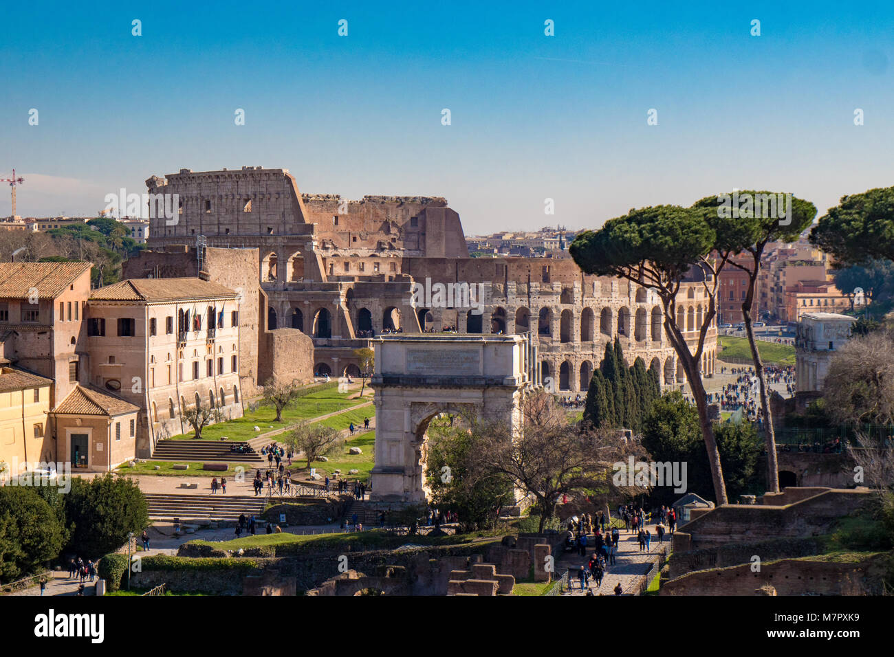 Titus Arch and the Roman Colosseum in Rome, Italy as seen from the Palatine Hill - Stock Image