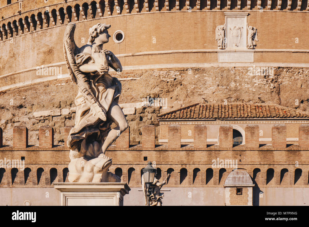 The statues on the Sant' Angelo Bridge in front of Sant' Angelo Castle in Rome, Italy - Stock Image