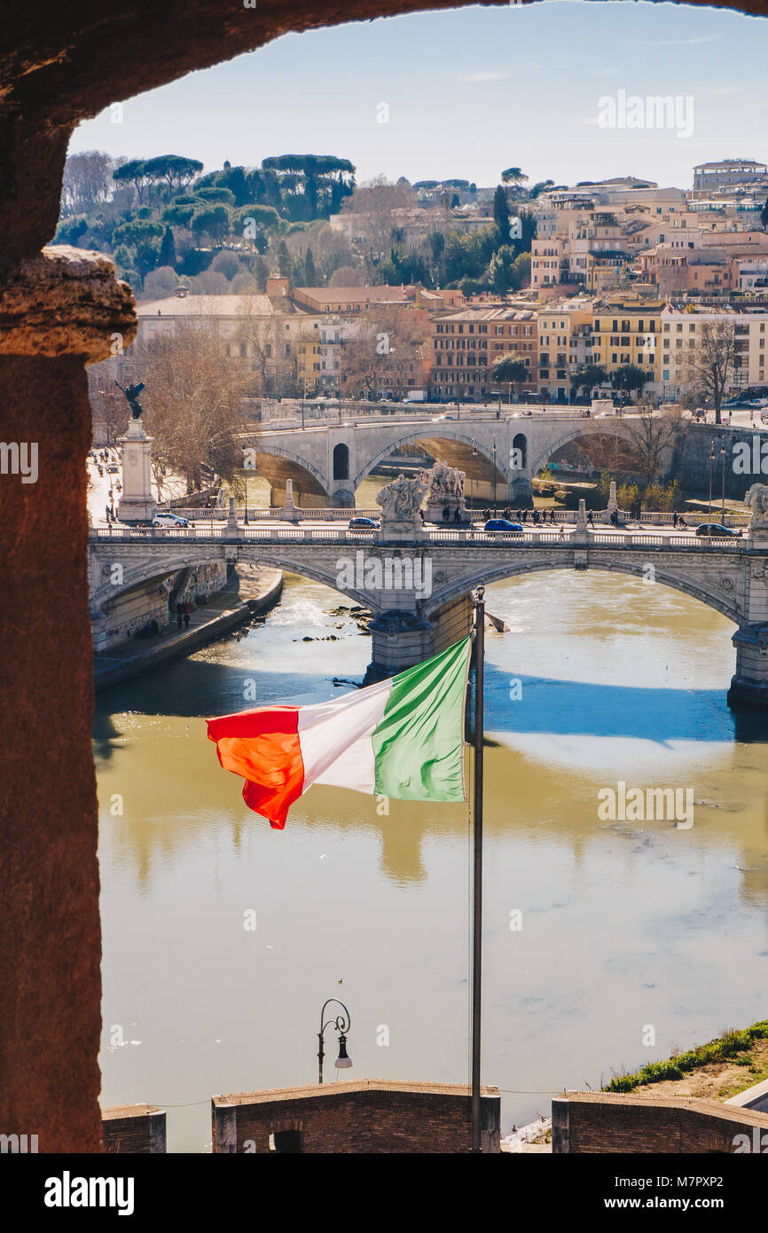 Rome city skyline and Italian Flag, as seen from Saint Angelo Castle in Rome, Italy - Stock Image