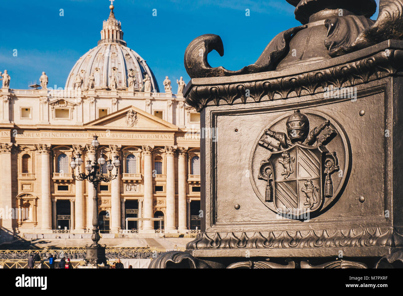 St. Peter's square and Saint Peter's Basilica in the Vatican City in Rome, Italy. Vatican symbol detail - Stock Image