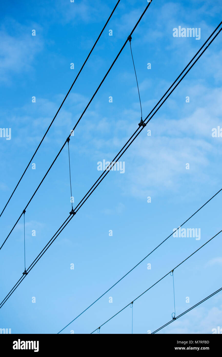 Power cables over a railway line - Stock Image