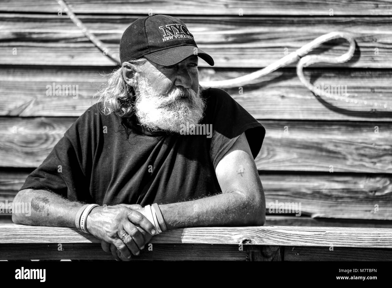 old fisherman on the wharf in key west - Stock Image