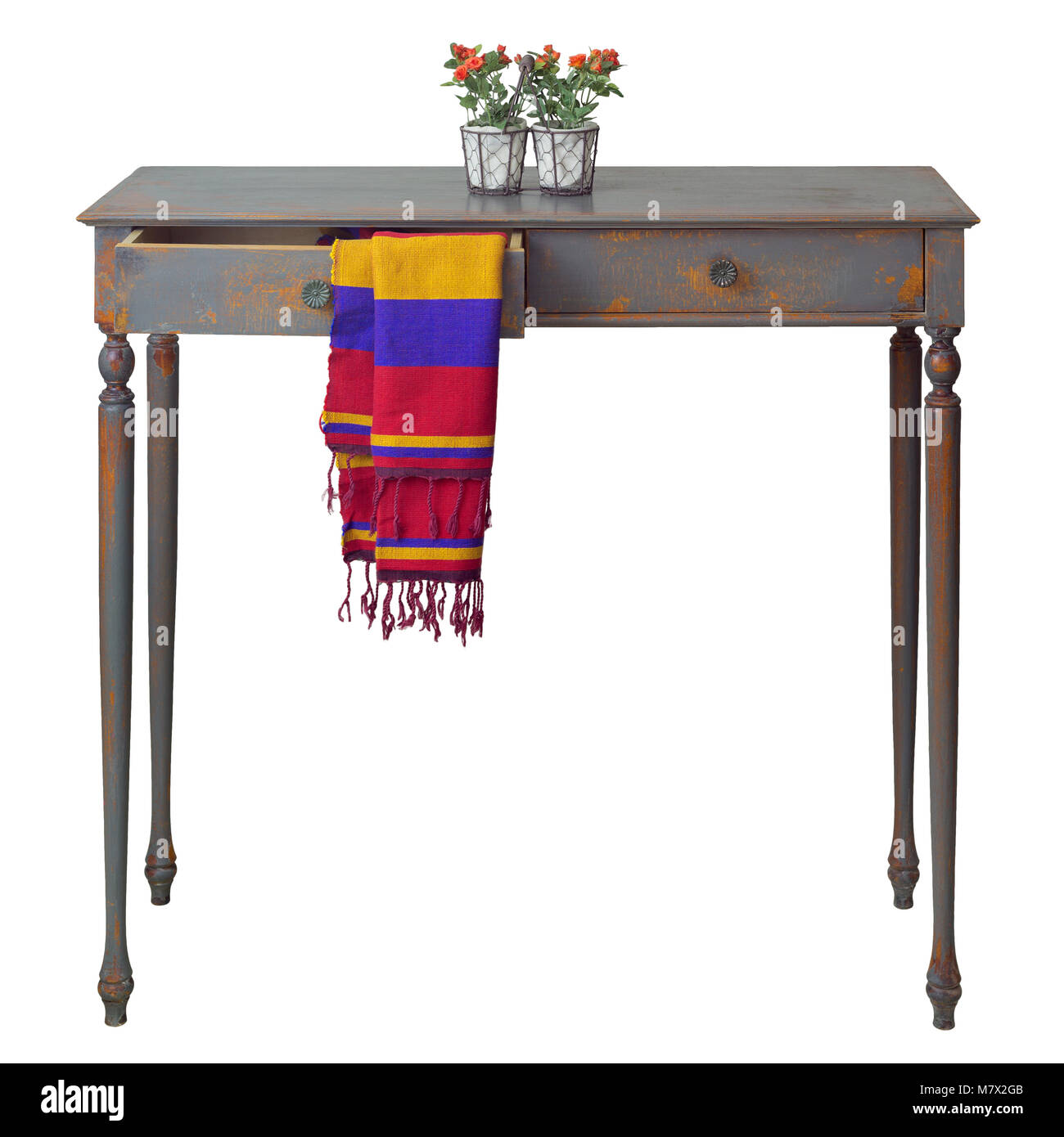 Vintage wooden table with two drawers painted in grey and orange with colorful scarf hanging down from one of the - Stock Image