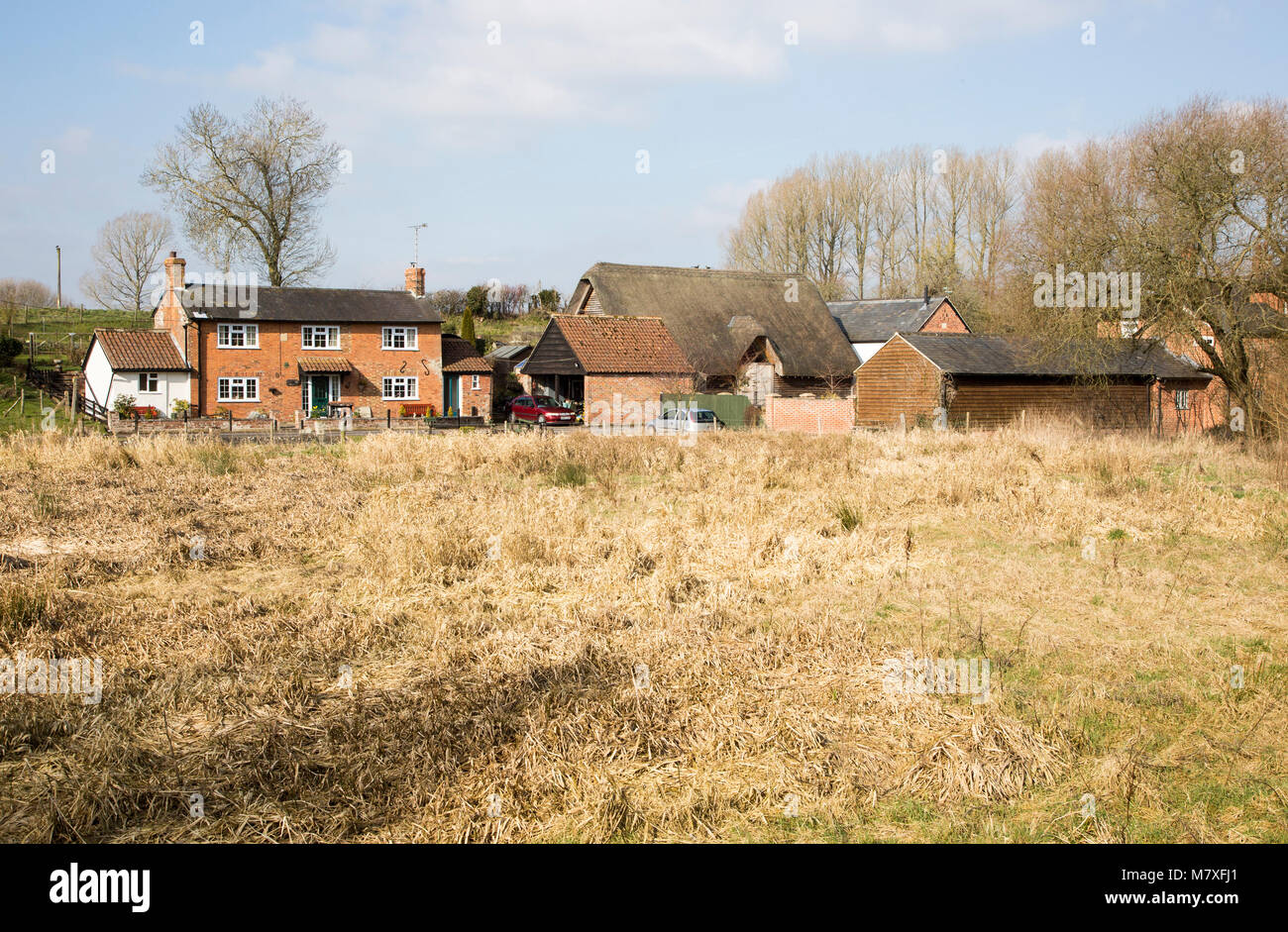 Pretty cottage and farm buildings, Marden village, Wiltshire, England, UK - Stock Image