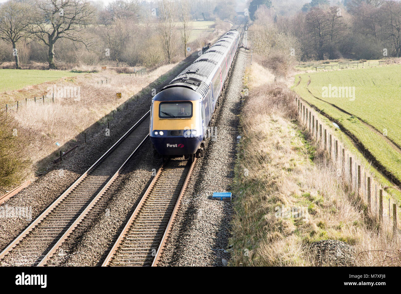 First Great Western train main west coast rail line at Woodborough, Wiltshire, England, UK - Stock Image