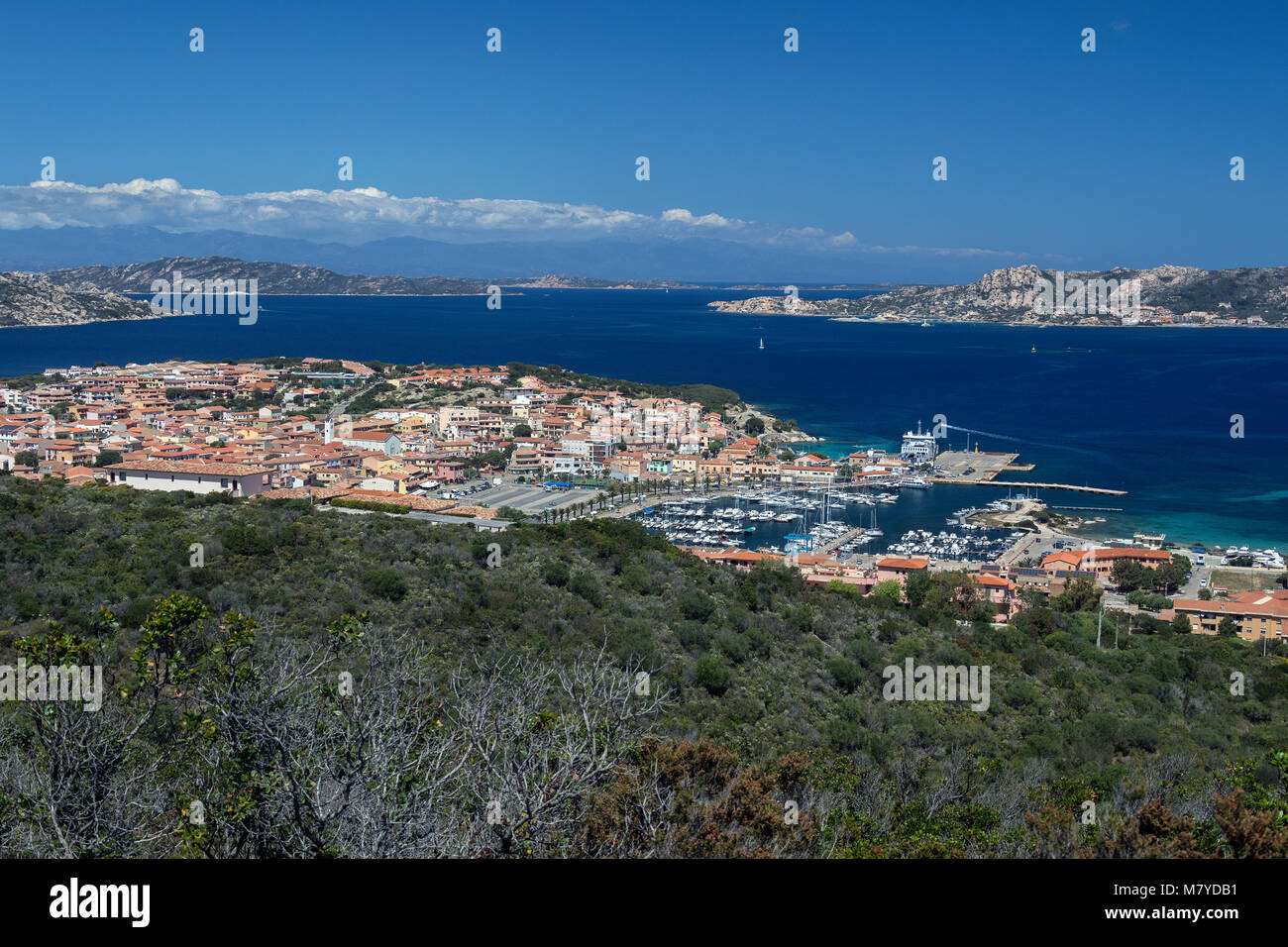 Palau in the Province of Sassari on the northeast coast of Sardinia, Italy. The mountain in the far distance are - Stock Image