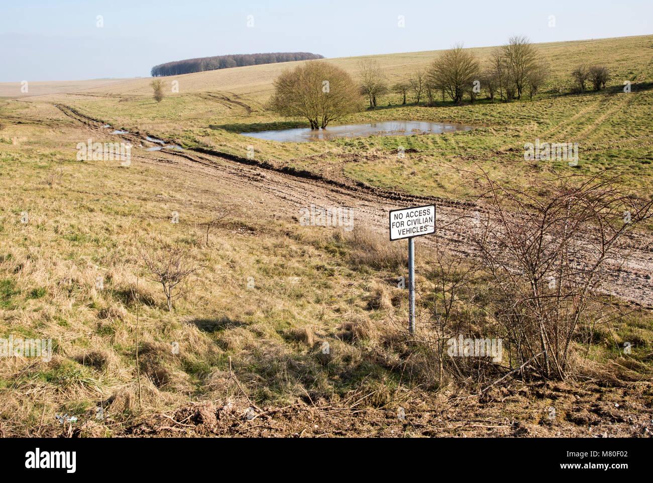 Chalk landscape scenery near Chitterne, Salisbury Plain, Wiltshire, England, UK sign no access for civilian vehicles - Stock Image