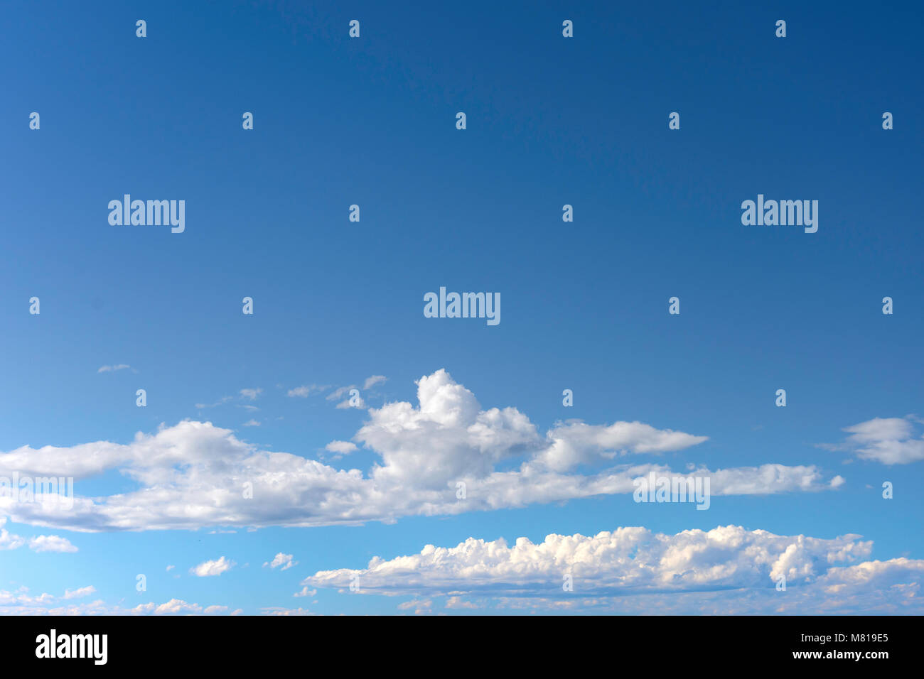 White cumulus clouds and blue sky, Christchurch, Canterbury, New Zealand - Stock Image