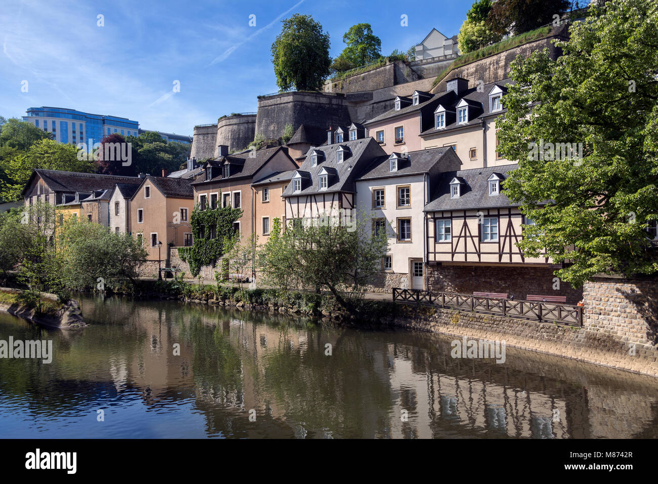 Luxembourg City - Ville de Luxembourg. The walls of the old town viewed from the Grund area of the city. - Stock Image