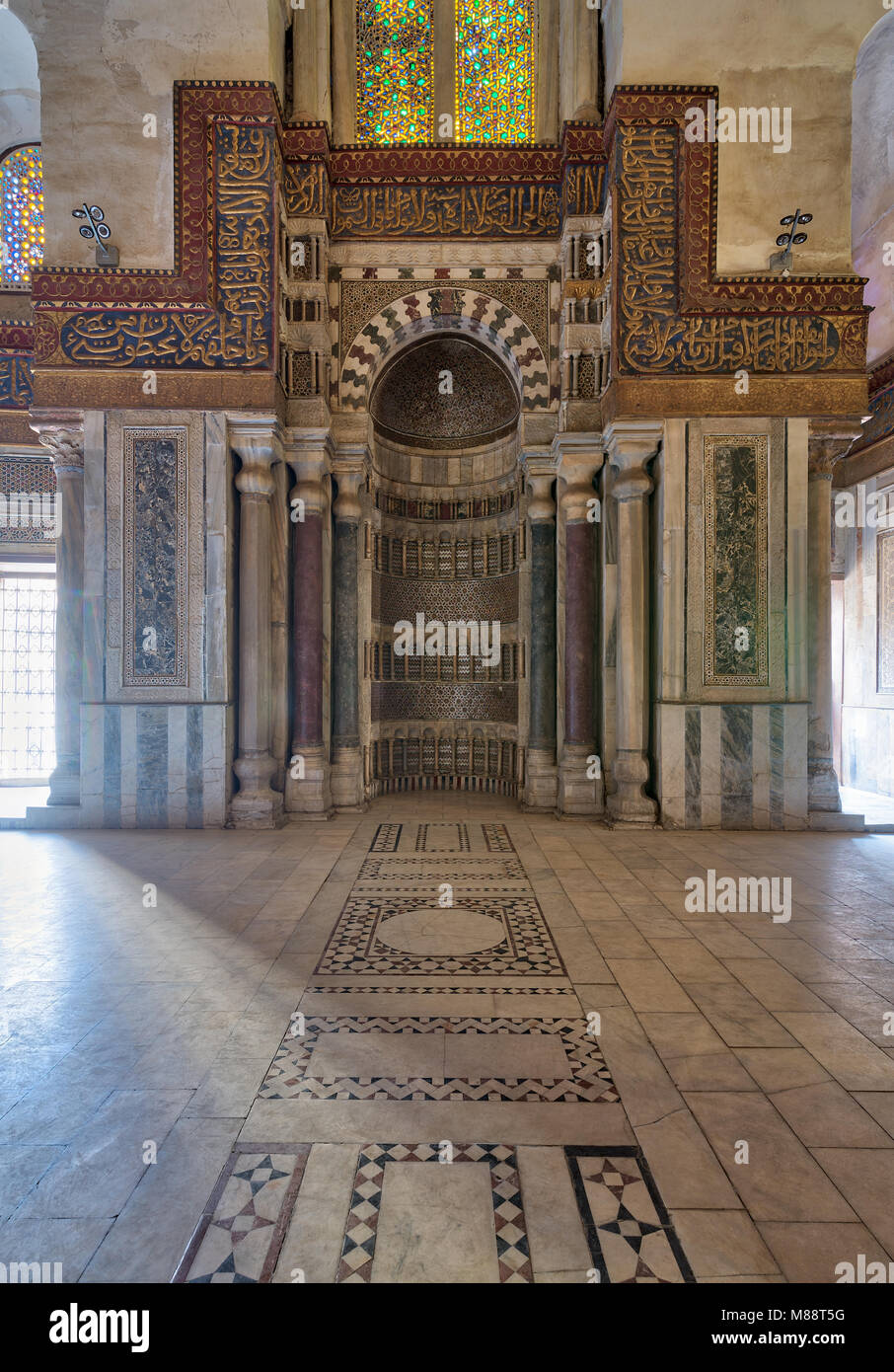 Cairo, Egypt - February 3, 2018: Mausoleum of Sultan Qalawun with decorated colorful marble niche (Mihrab) embedded - Stock Image