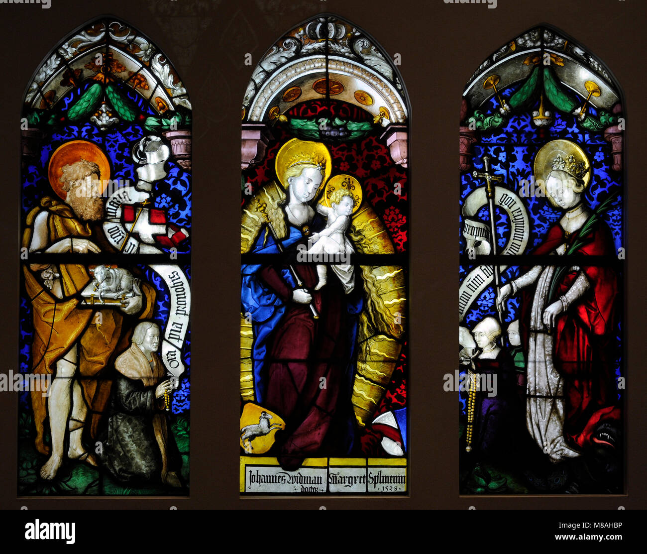 Virgin in an Aureola with St. John the Baptist and St. Margarete from the Charterhouse in Freiburg, Germany. Workshop - Stock Image