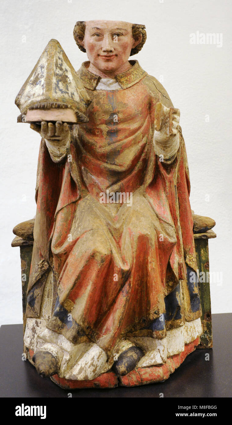 St. Dionysius. Cologne, c. 1330. Walnut, polychrome. Schnütgen Museum. Cologne, Germany. - Stock Image