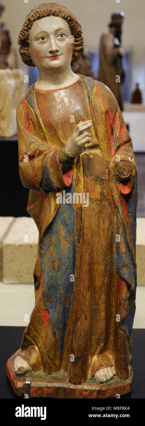 Saint John the Evangelist. Walnut, polychrome. Cologne, c. 1330, Germany. Schnütgen Museum. Cologne, Germany. - Stock Image