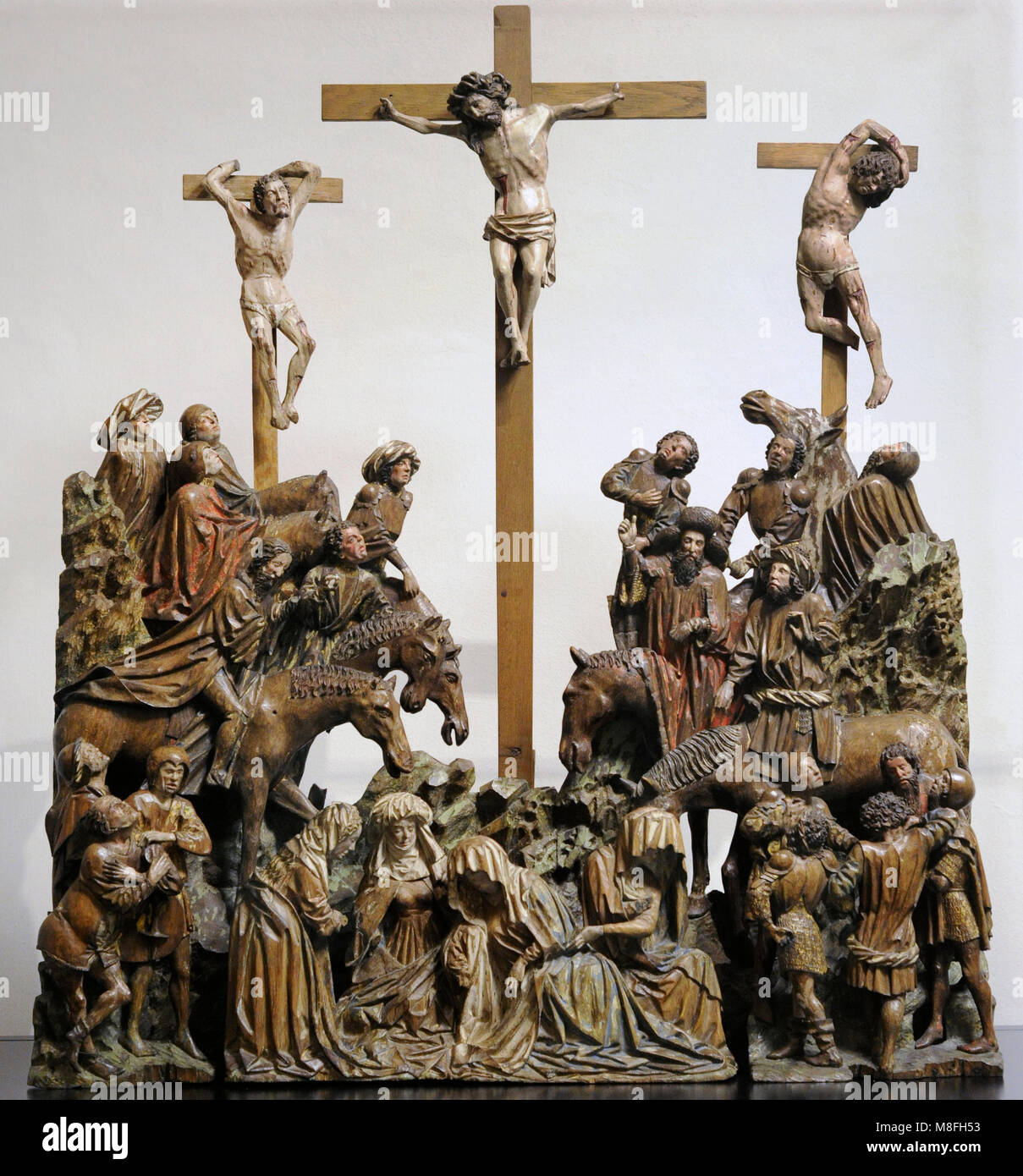 Crucifixion (Calvary). Sculptural group. Southern Netherlands, c. 1430-1440. Oak, polychrome. Schnütgen Museum. - Stock Image