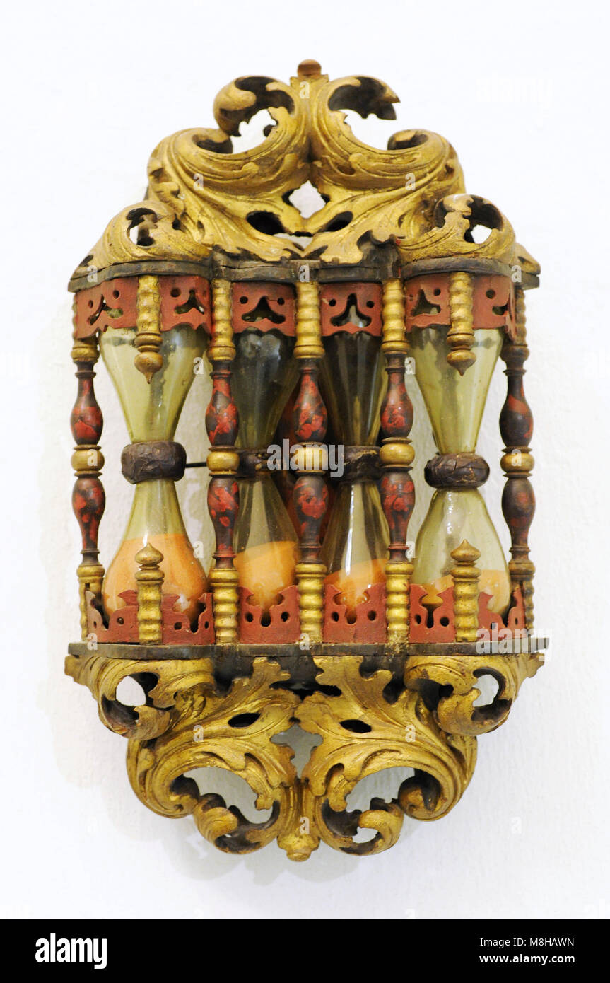 Pulpit hourglass. Breinum, near Hildesheim, Germany. Late 17th century. Wood with green glass, filled with red sand. - Stock Image