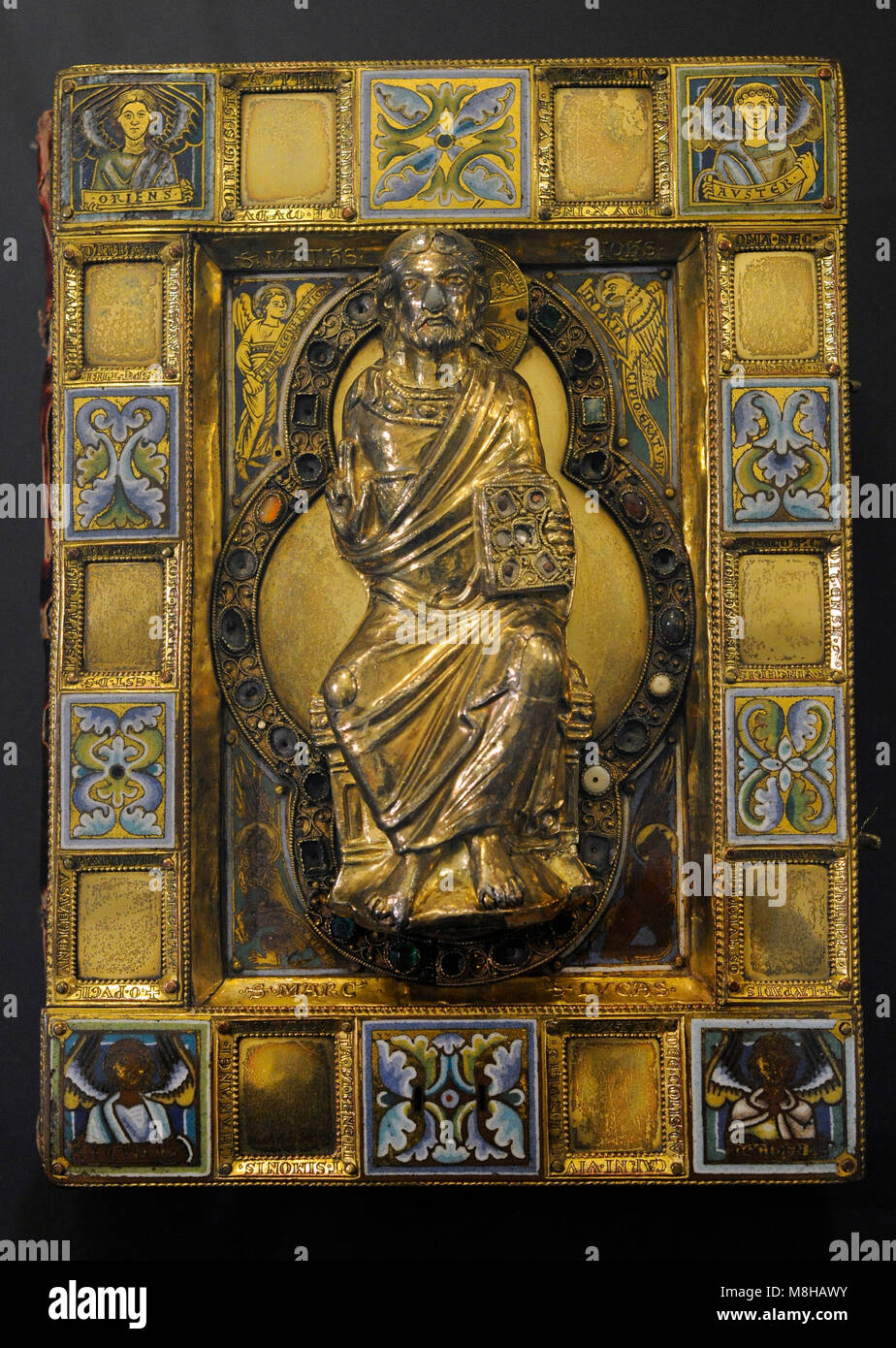 Golden book cover of a Carolingian Gospel Book. Cologne, c. 1160-1180. Germany. Gilt silver with enamel, studded - Stock Image