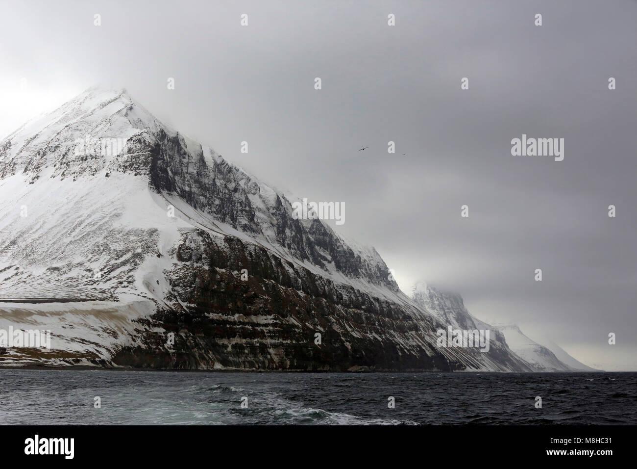 Snowy Mountains outside Longearbyen, Viewed from Water. Svalbard, Norway - Stock Image