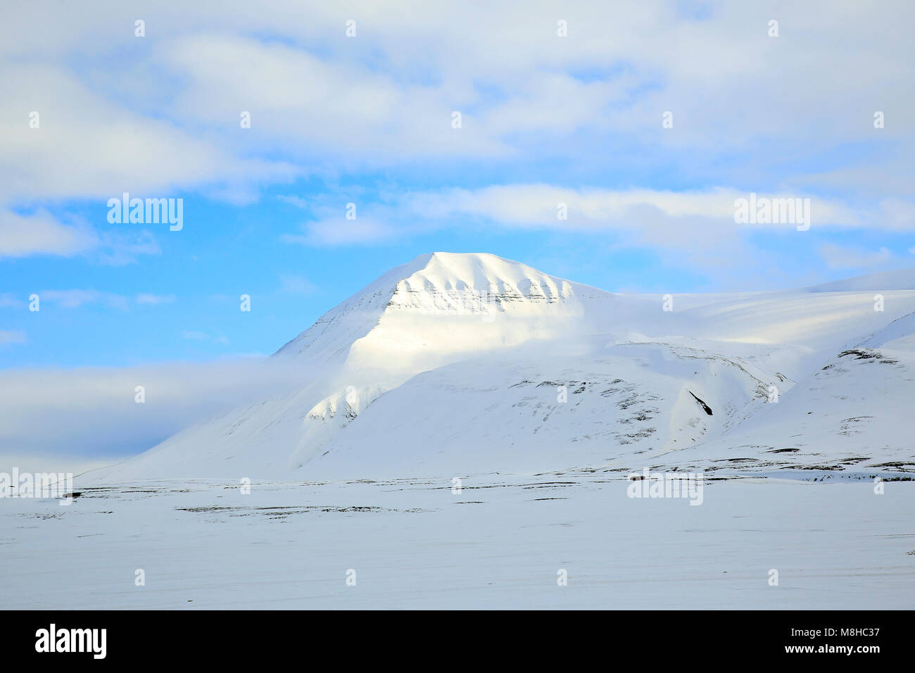 Snow-covered Mountain at Spitsbergen. Svalbard, Norway - Stock Image