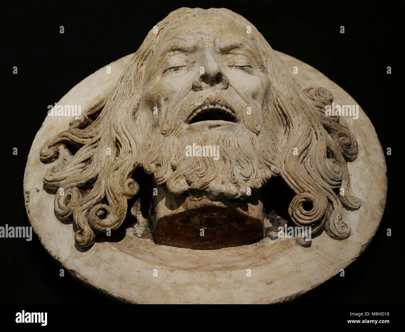 Head of st. John the Baptist on a platter. Rhineland, c. 1480-1520. Limestone, remains of polychromy. Museum Schnütgen. - Stock Image