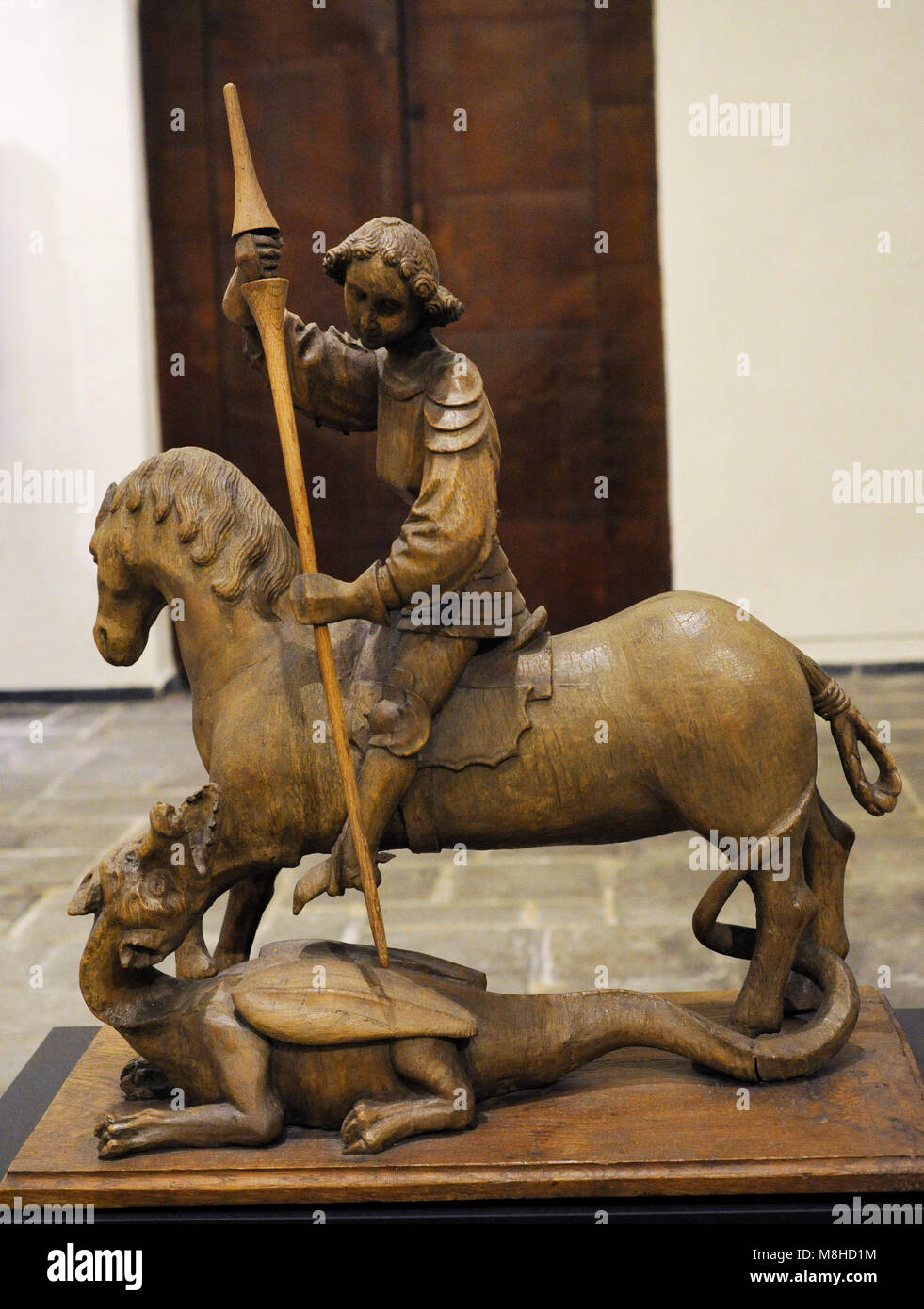 Saint George and the Dragon. Oak. Middle Rhine, Germany. 15th century. Museum Schnütgen. Cologne, Germany. - Stock Image
