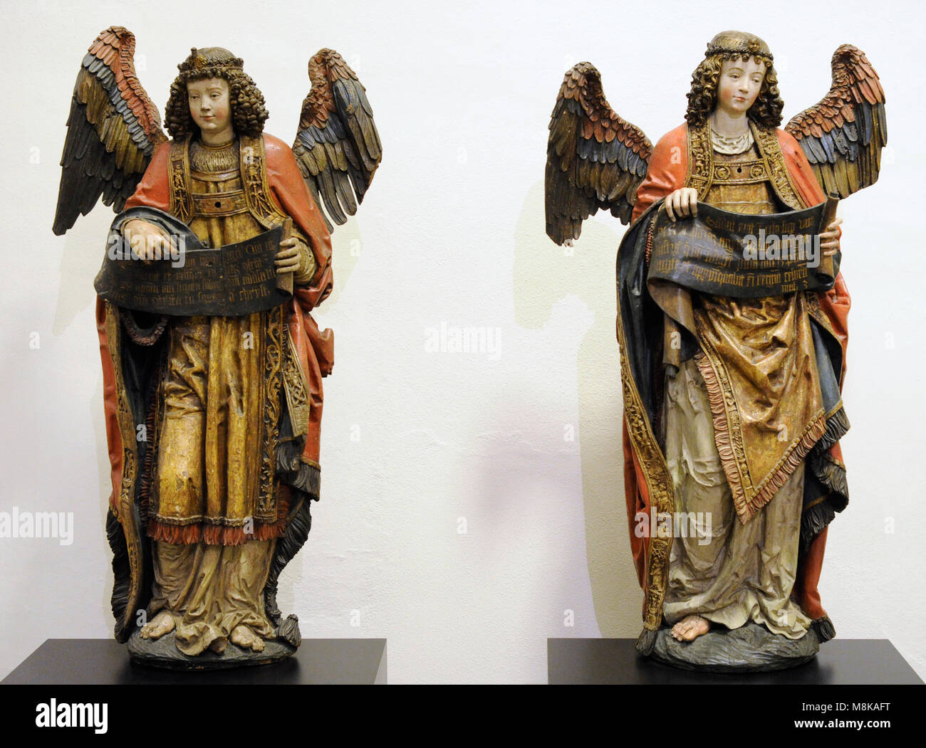 Two angels with banners. Cologne, Germany, c. 1530. Lime, polychrome. Museum Schnütgen. Cologne, Germany. - Stock Image