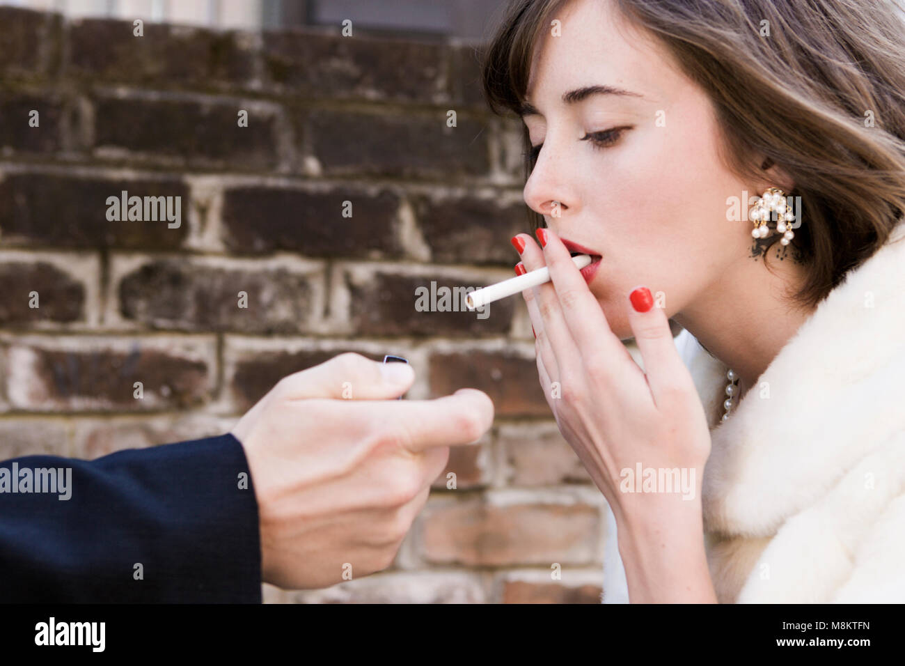 Lady Smoking A Cigarette Stock Photos & Lady Smoking A Cigarette Stock Images - Alamy