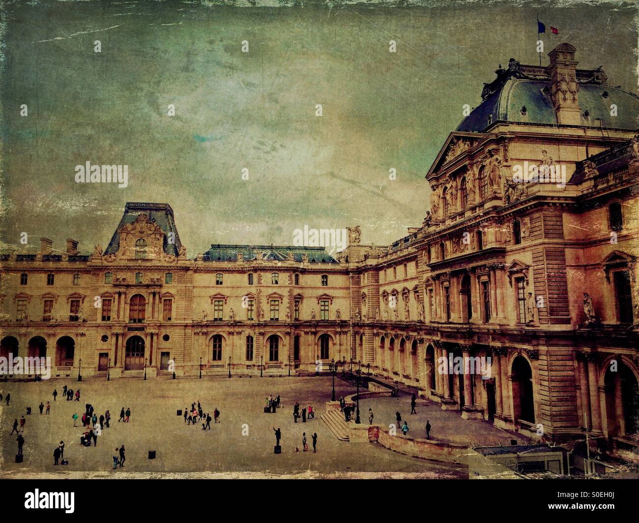 View of Musée du Louvre in Paris, France, taken from a second floor window. Tourists milling  below. Vintage texture Stock Photo
