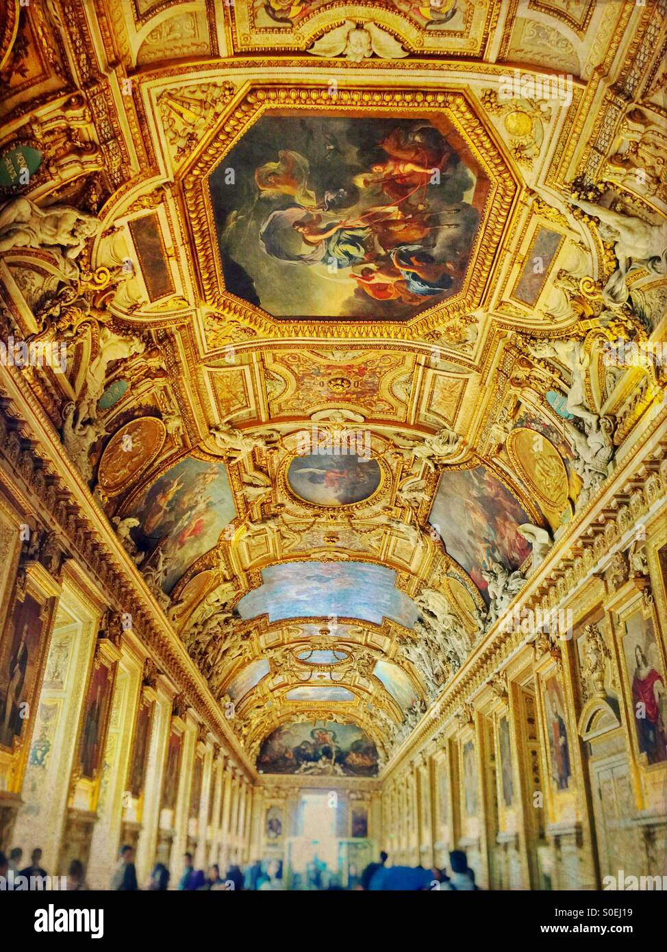 The golden Galerie d'Apollon famous for its high vaulted ceilings with painted decorations and stucco sculptures. Stock Photo