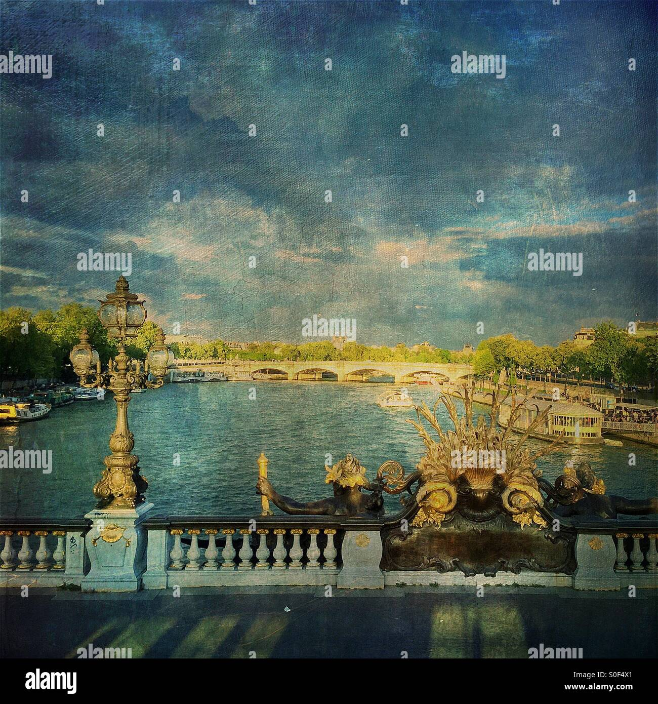 View of the Seine River from Pont Alexandre III, regarded as the most ornate, extravagant bridge in Paris. French Stock Photo