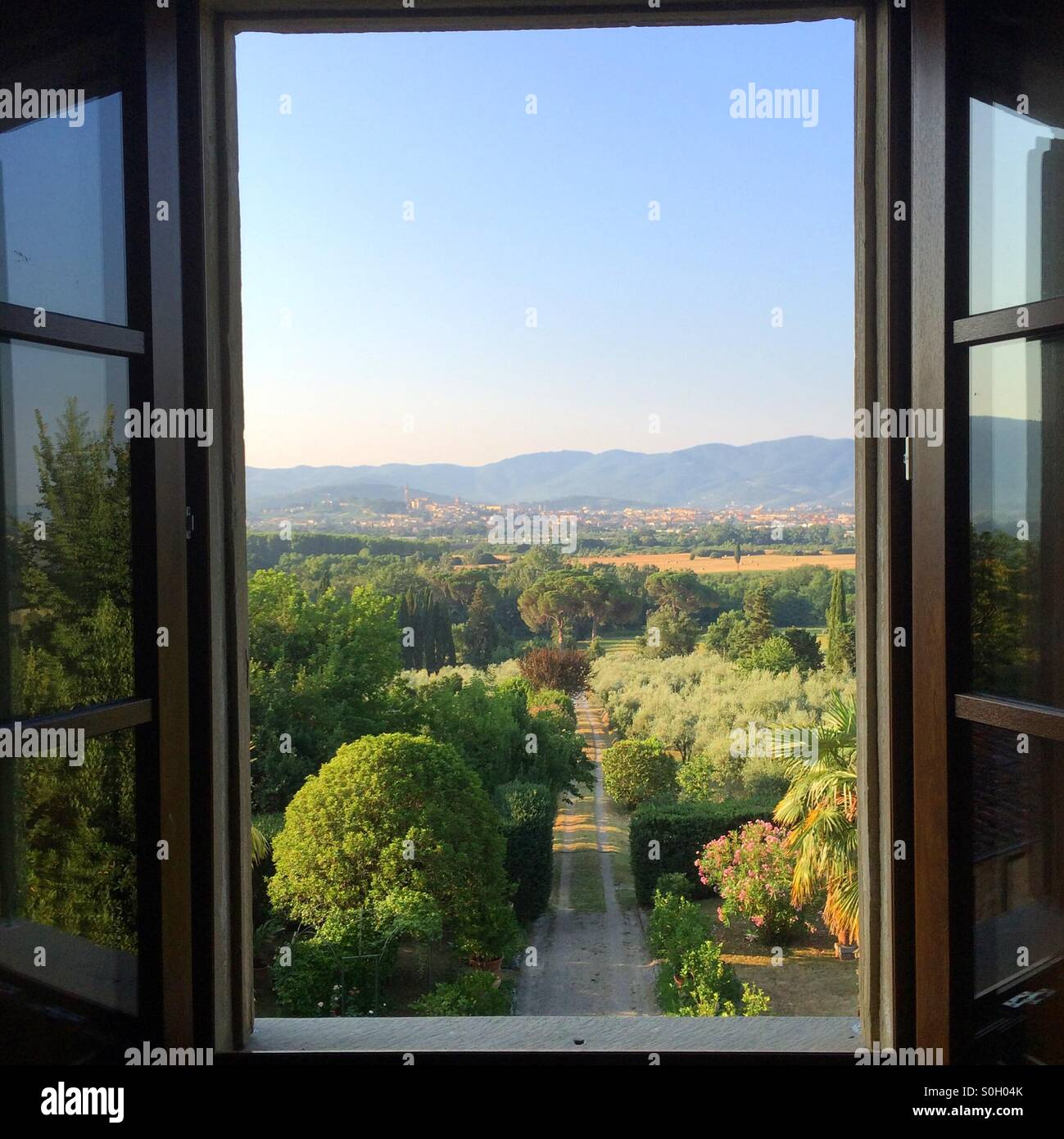 An Open Window With A View Of Tuscany And Arezzo From