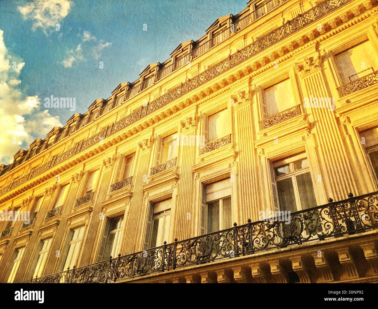Beautiful old apartment building with classical architecture along Les Grands Boulevards in Paris, France. Vintage Stock Photo