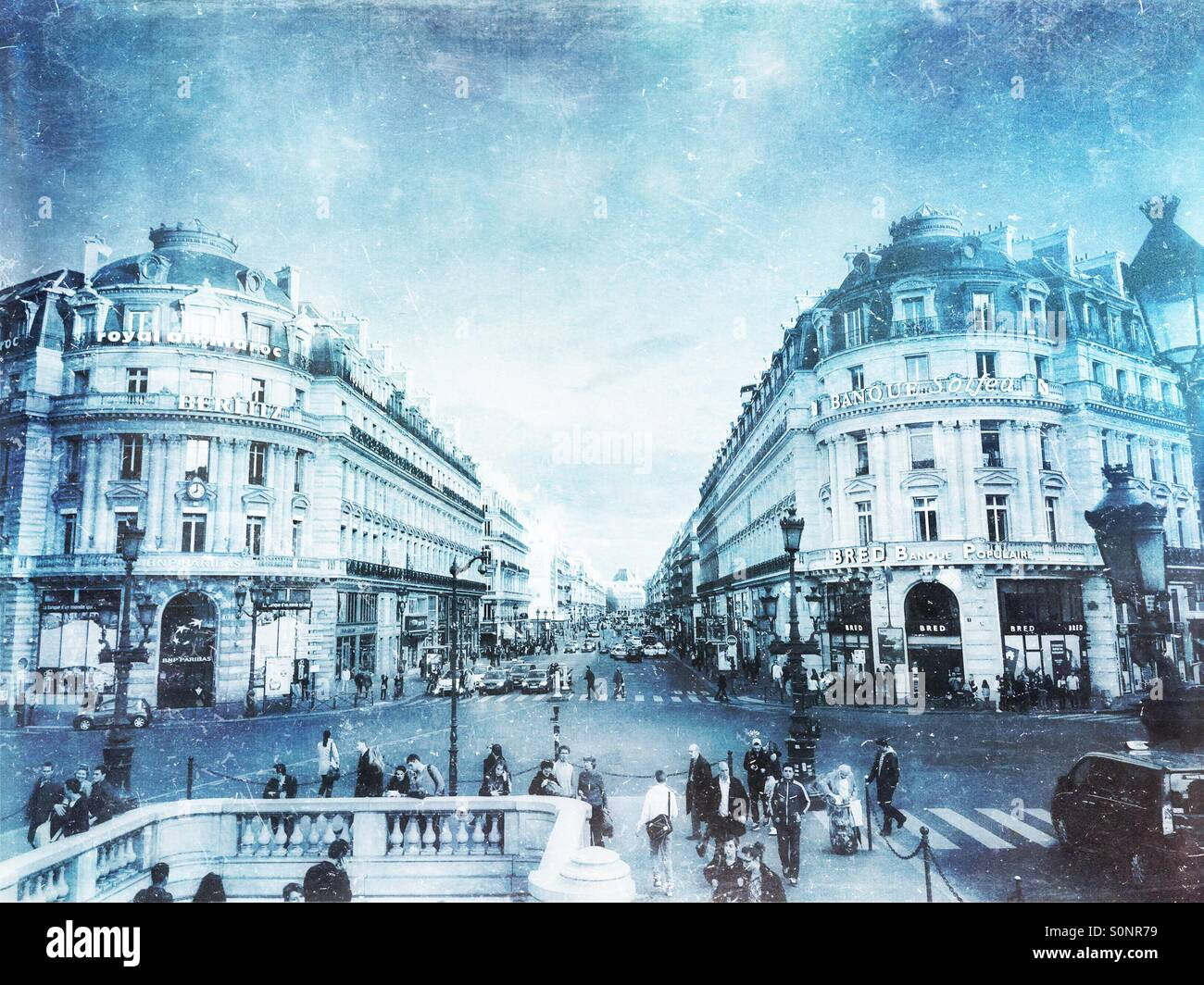 View of street intersection with classical architecture along Les Grands Boulevards in Paris, France. Frosty, winter Stock Photo