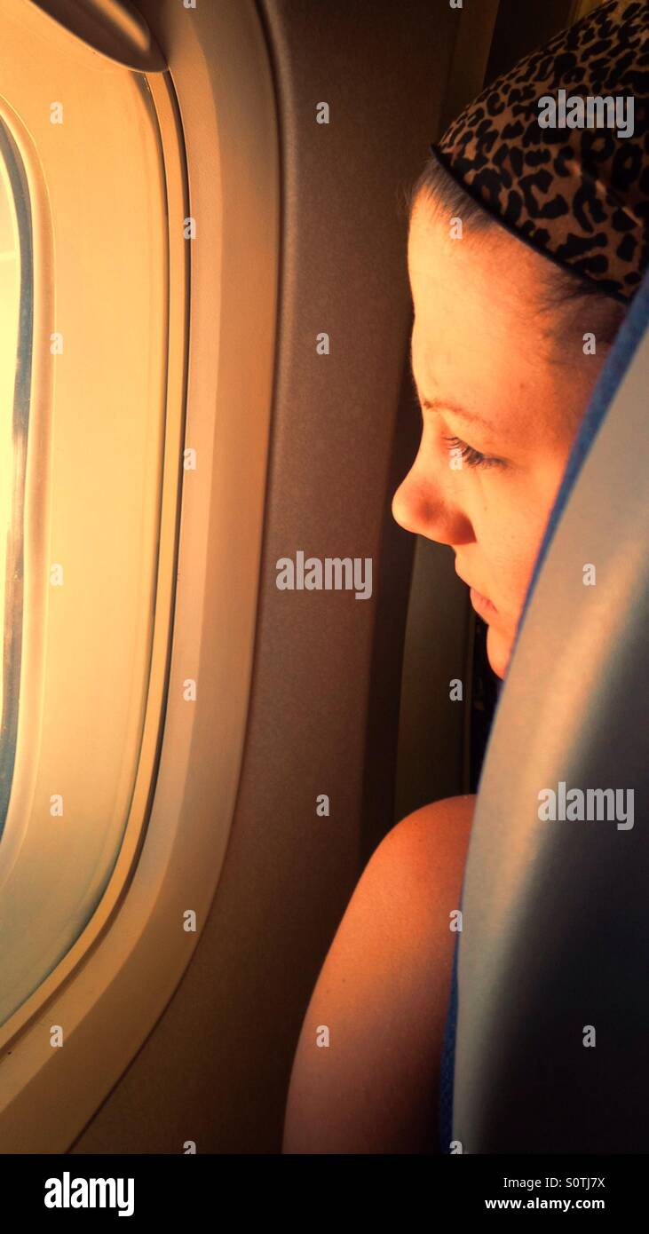 woman-looking-out-of-plane-window-with-s