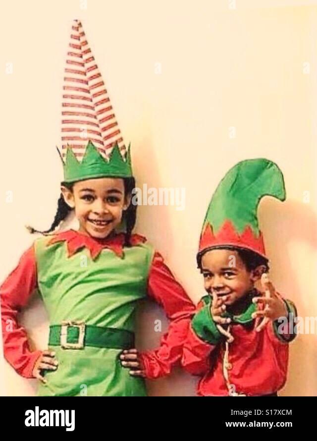 Two children in elf costumes. Stock Photo