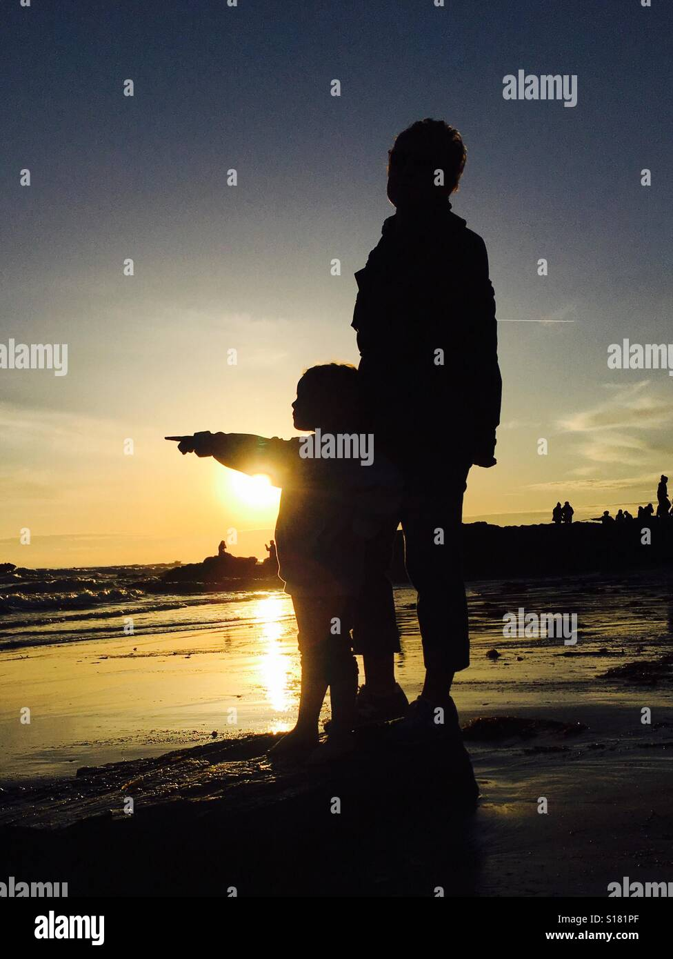 Mother and daughter beach sunset Stock Photo