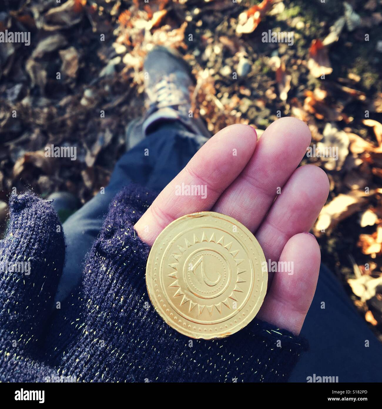 Chocolate coin on a country walk Stock Photo