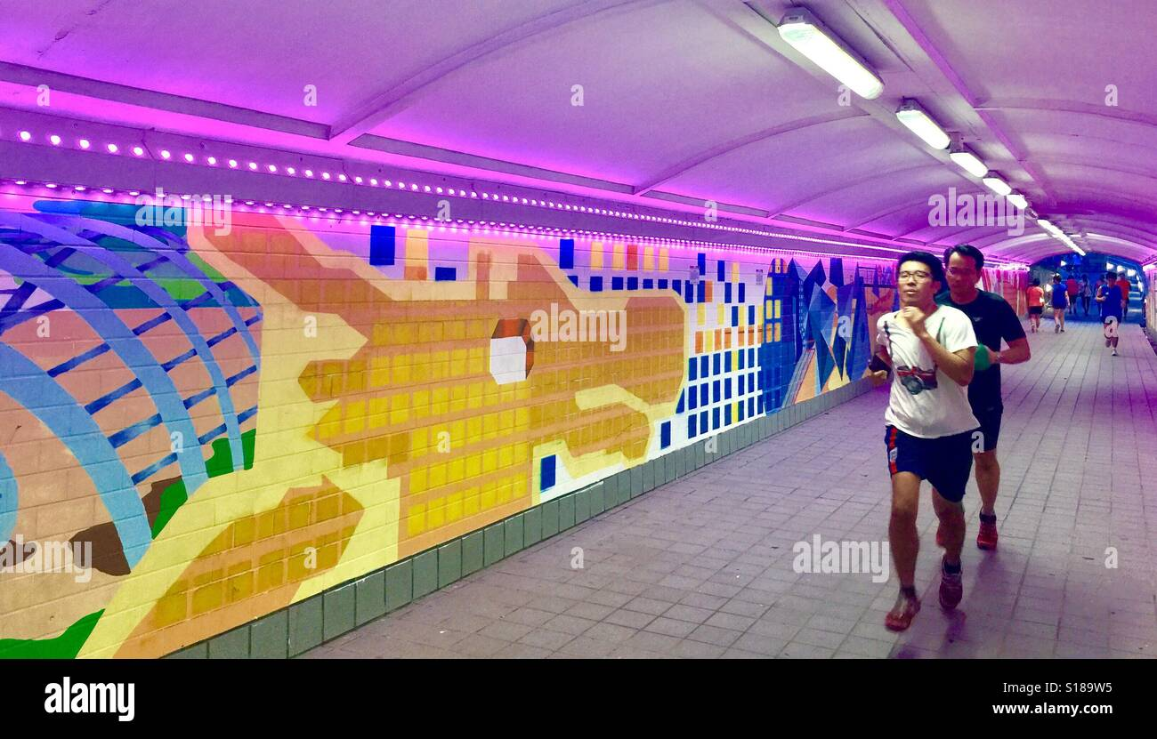 Singapore joggers at Singapore's Clark Quay underpass Stock Foto