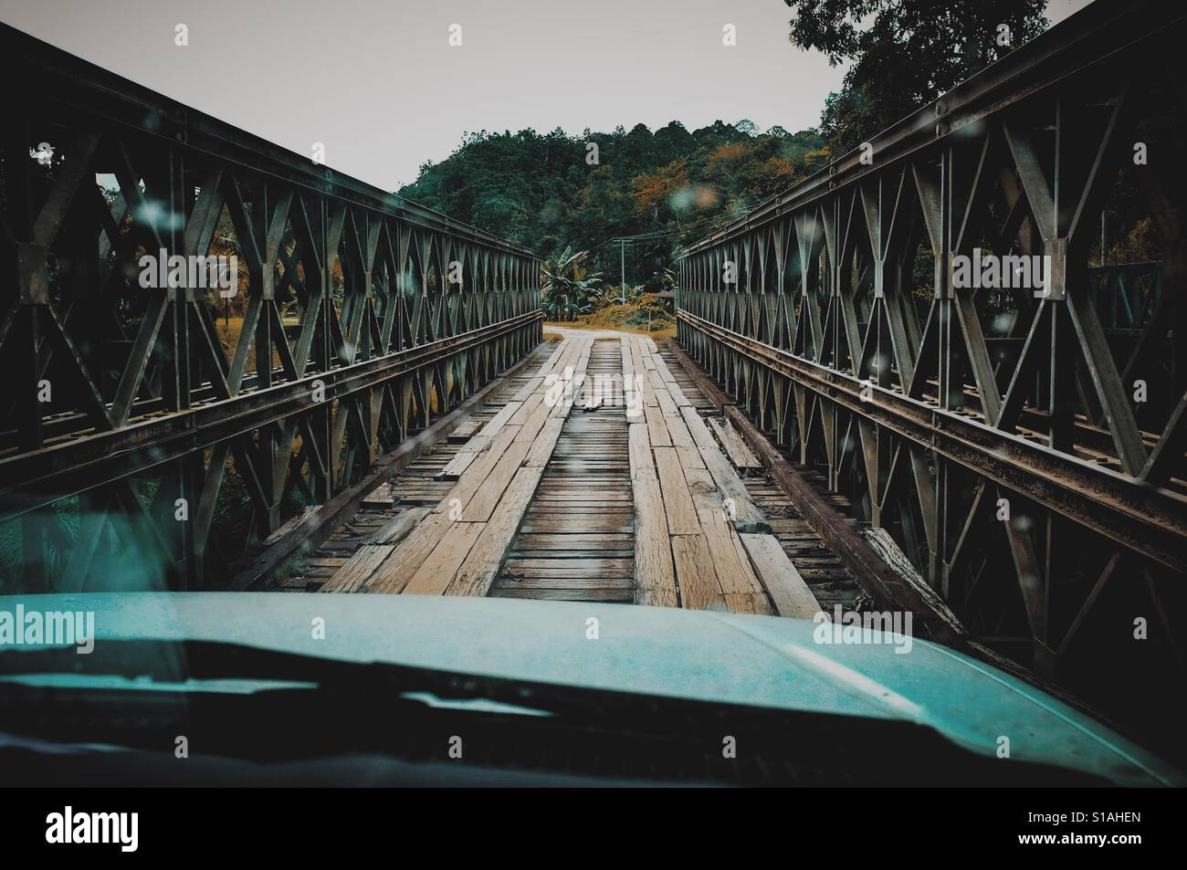 Crossing the wooden bridge Stock Foto