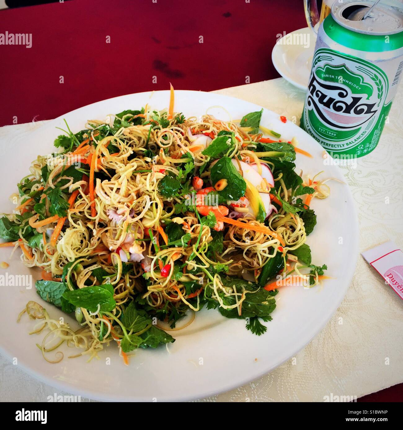Stock Photo - Traditional Vietnamese salad and Huda beer