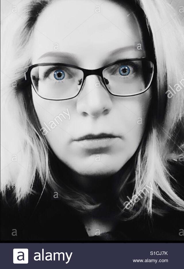 Headshot of a woman with glasses Stock Foto