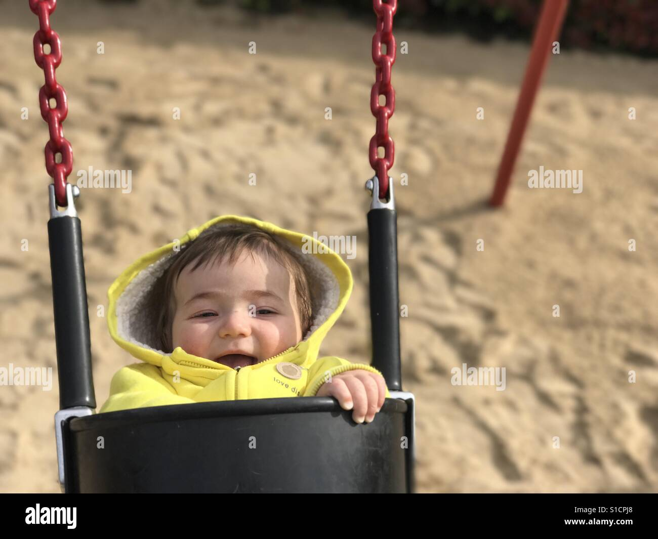 Baby swinging on the playground Stock Foto