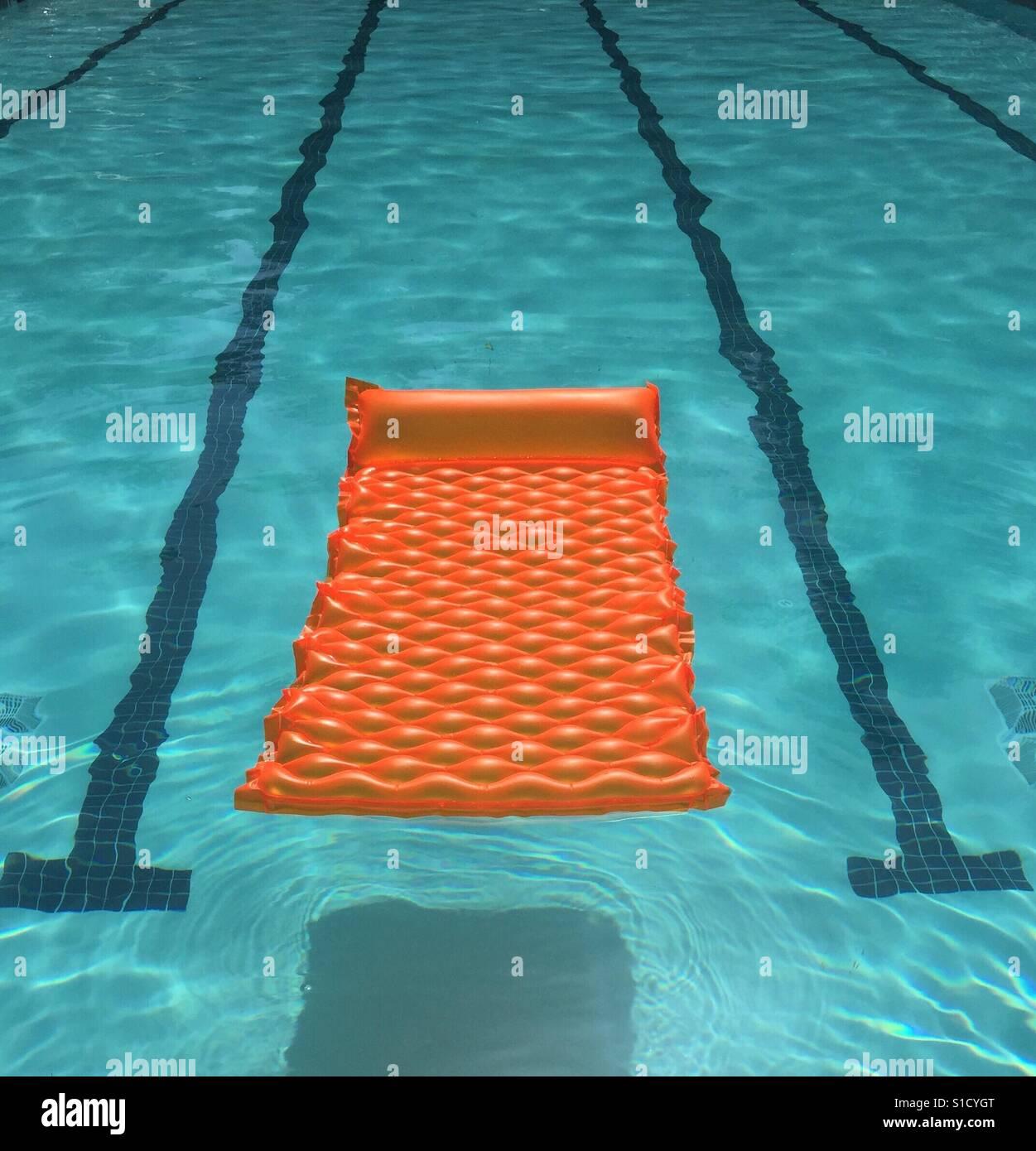 Orange Float in Pool Stock Foto