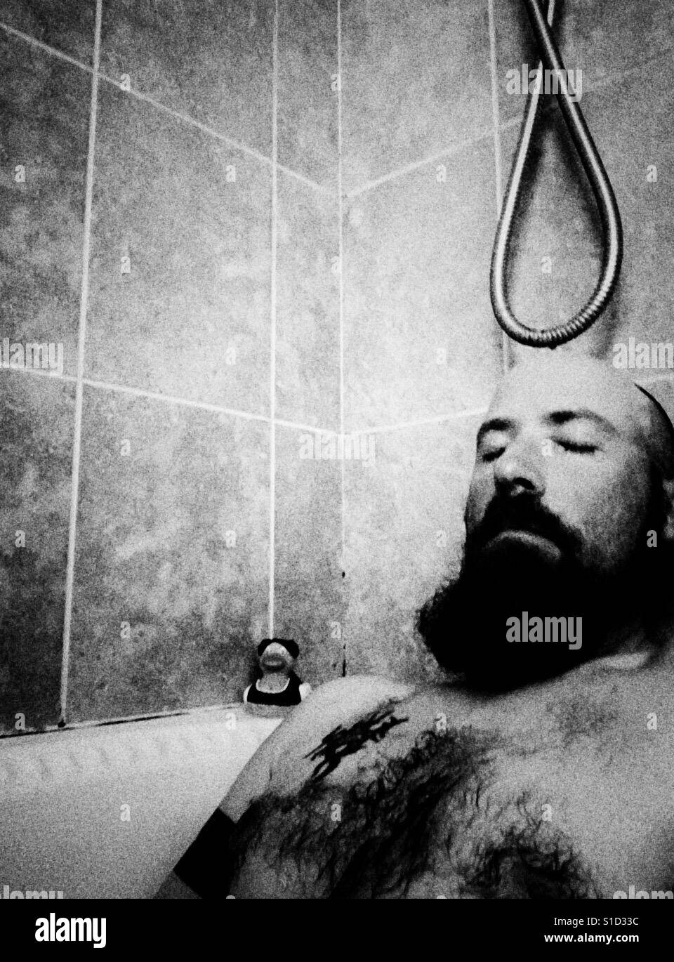Man in bath b/w Stock Foto