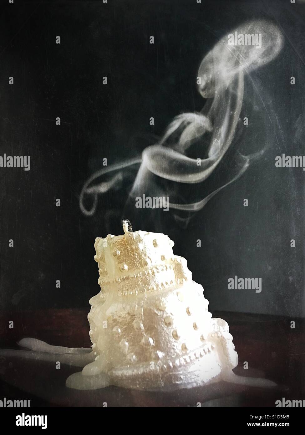 An extinguished wedding cake candle. Stock Foto