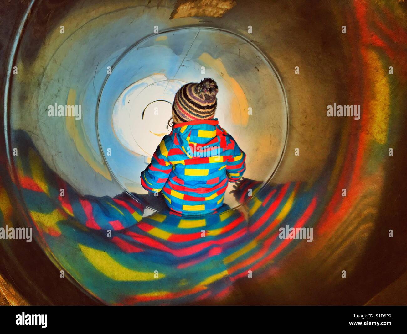 Child in sliding tube Stock Foto