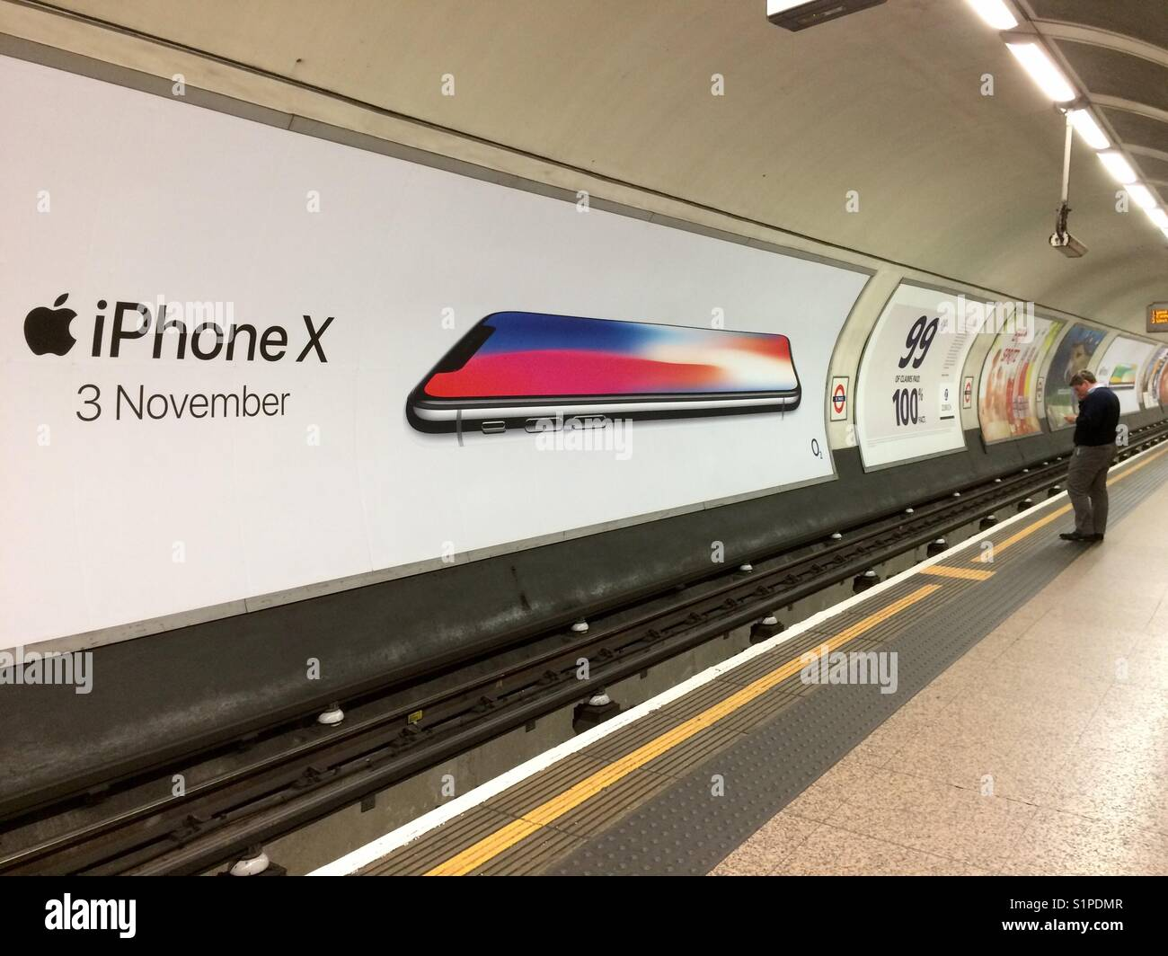 iPhone X advertisement poster on the London Underground ...