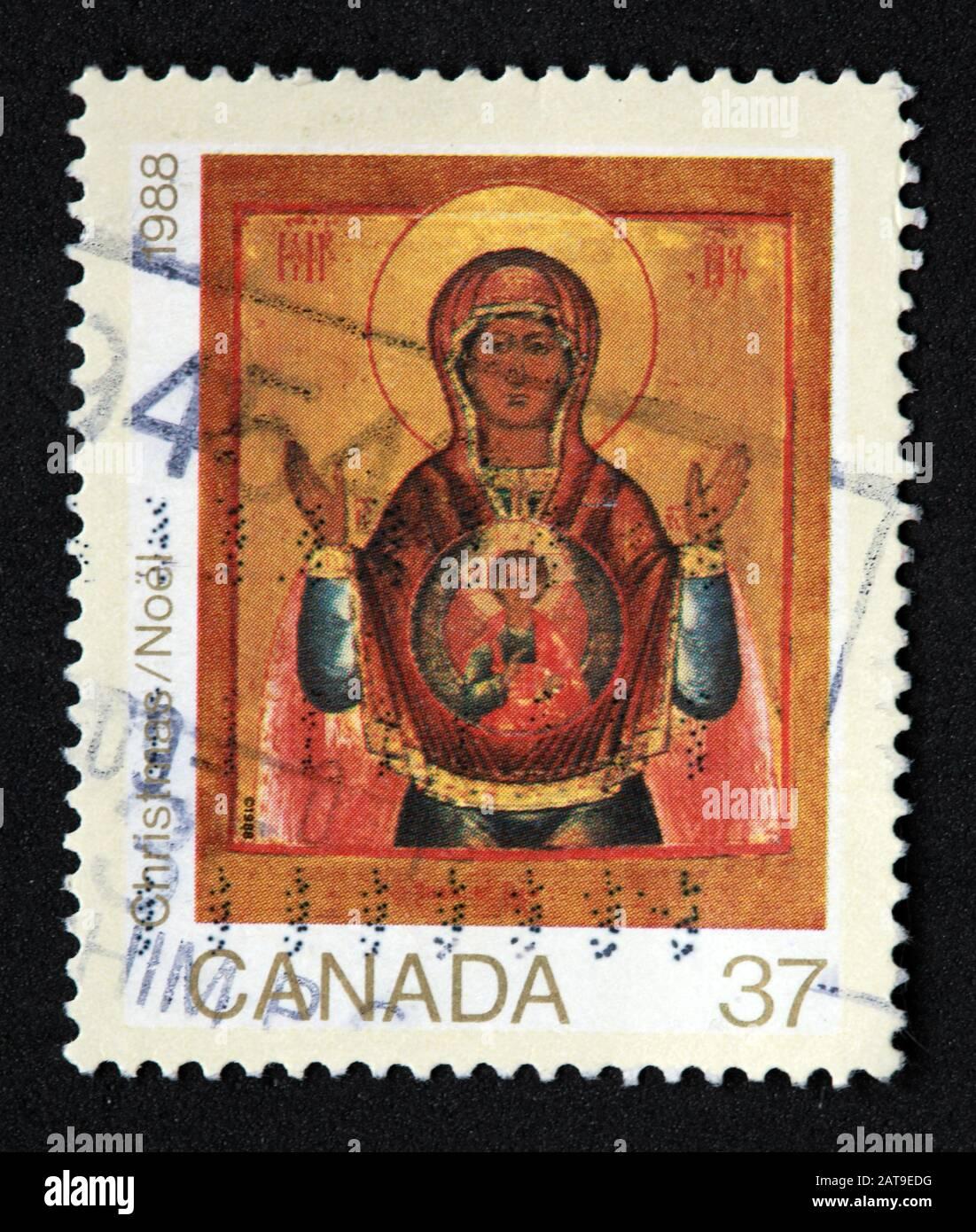 Dieses Stockfoto: Kanadische Briefmarke, Canada Stamp, Canada Post, used Stamp, Canada 37c Christmas, Xmas, 1988, Angel, Christ, Stamp - 2AT9ED
