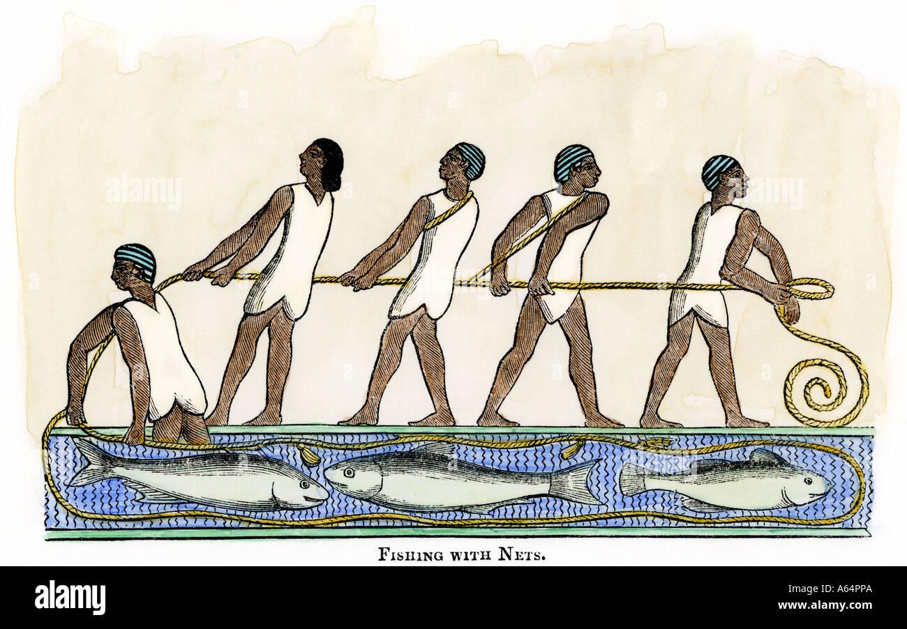 Fischen mit Netzen im alten Ägypten Stockbild
