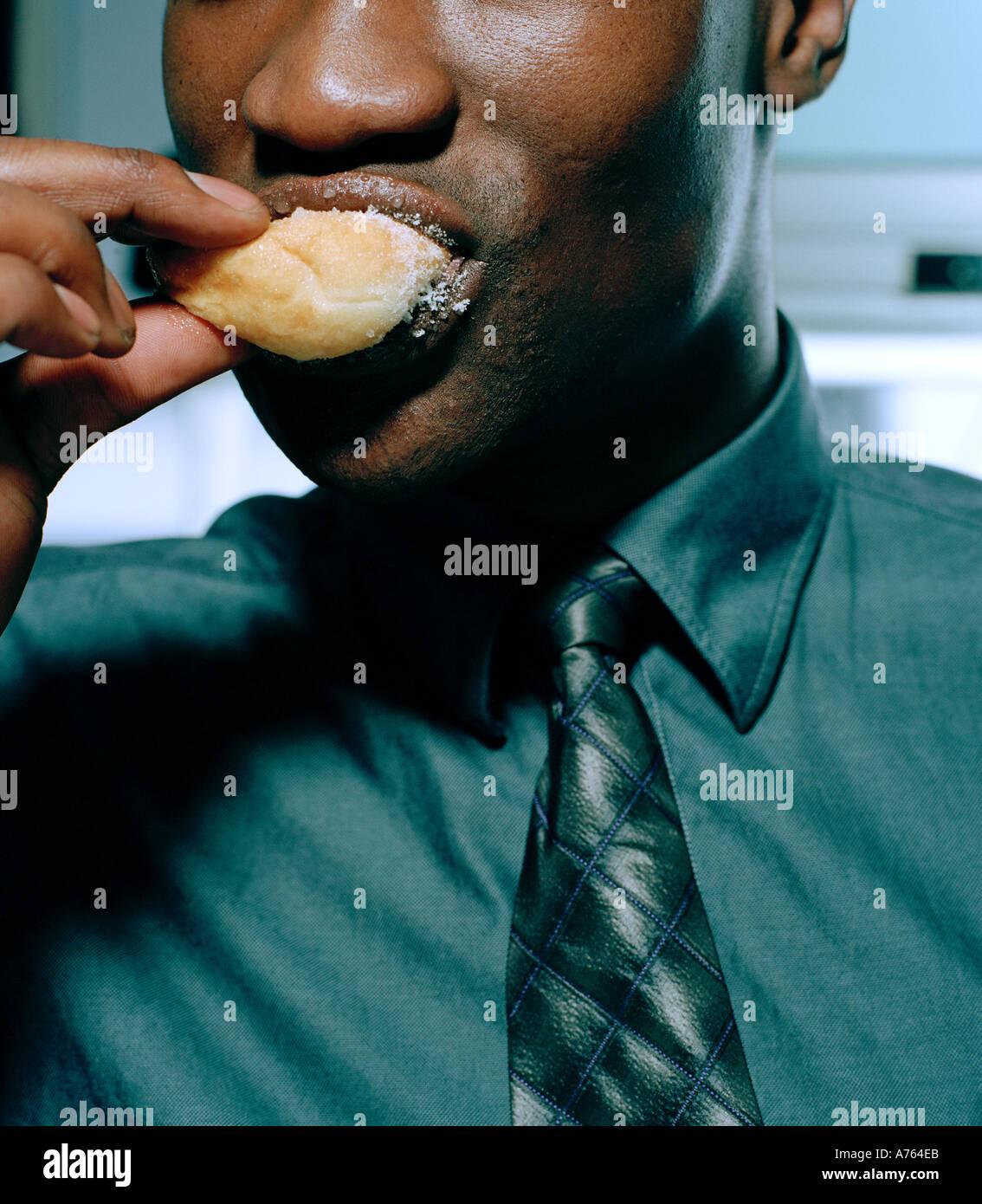 Büroangestellter Donut Essen Stockbild